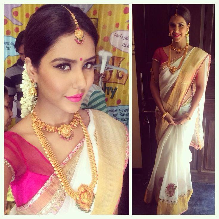 South Indian bride. Temple jewelry. Jhumkis.White silk kanchipuram sari.Kerala kasavu mundu set.Braid with fresh jasmine flowers. Tamil bride. Telugu bride. Kannada bride. Hindu bride. Malayalee bride.Kerala bride.South Indian wedding