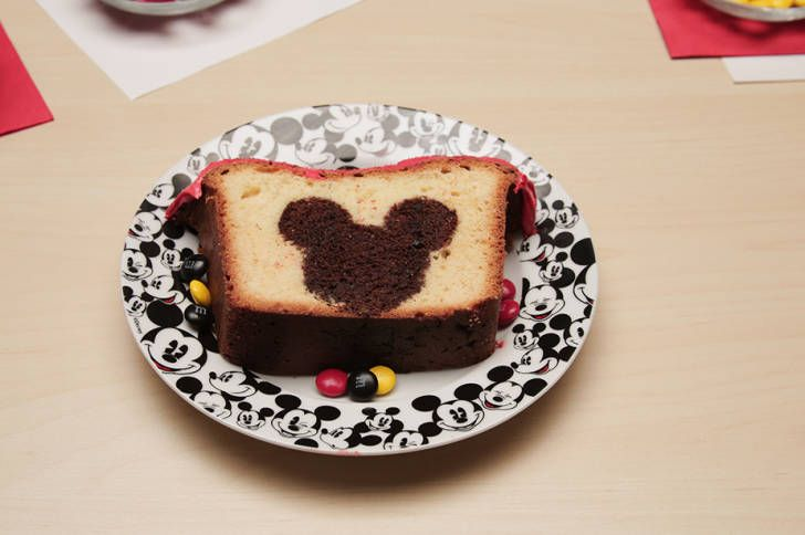 Serve up a slice of Disney magic this weekend with this Mickey Mouse Peekaboo Cake. Your guests will love discovering their very own hidden Mickey! Prep Time: 30 mins Cook Time:1 hr Total Time:1 hr 30 mins What You'll Need Pound cake mix and required ingredients Chocolate pound cake (Bake your own or find one...