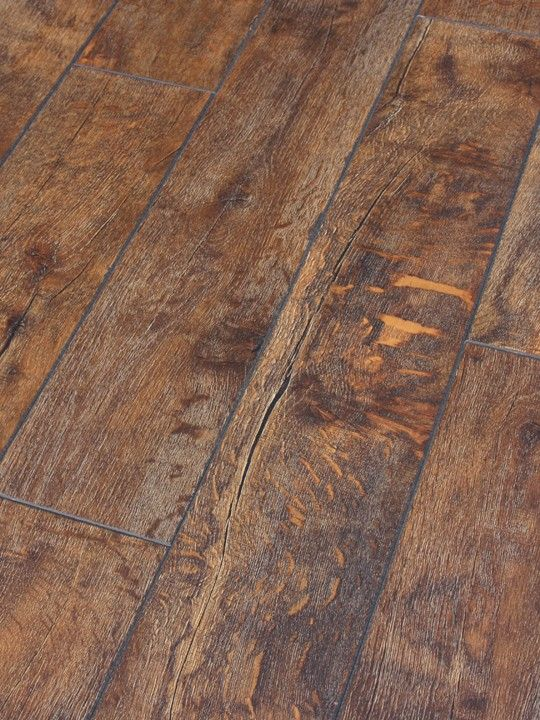 The most realistic looking Rustic laminate by Dezign. We challenge you to  tell the difference in reclaimed wood and this rustic oak laminate floor  from