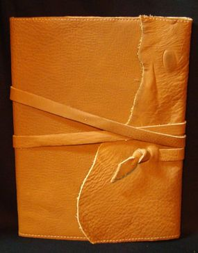 DIY: Make a rugged,rustic leather journal cover - Perfect for Artists/Writers -  looks impressively hard-wearing....  [might try it as  the spines on my moleskines start to fray after a few months?:P]