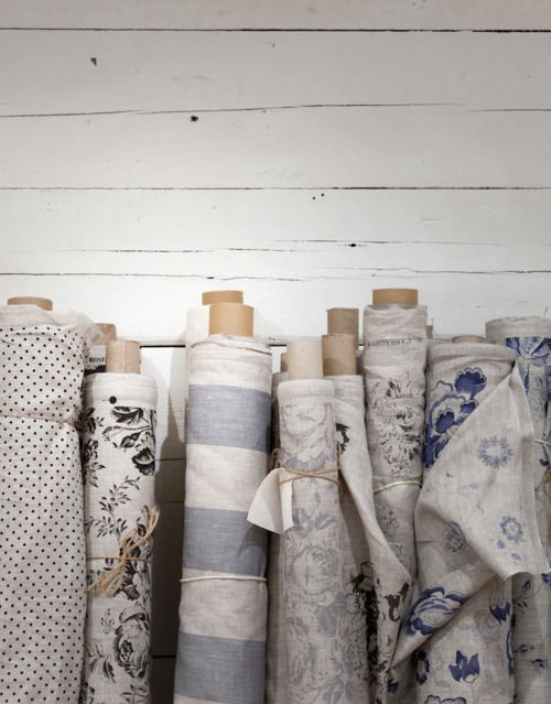 modernhepburn:    Fabric rolls always remind me of my mother. I spent numerous afternoons, as a child, in Calico Corners picking out fabric for our furniture.