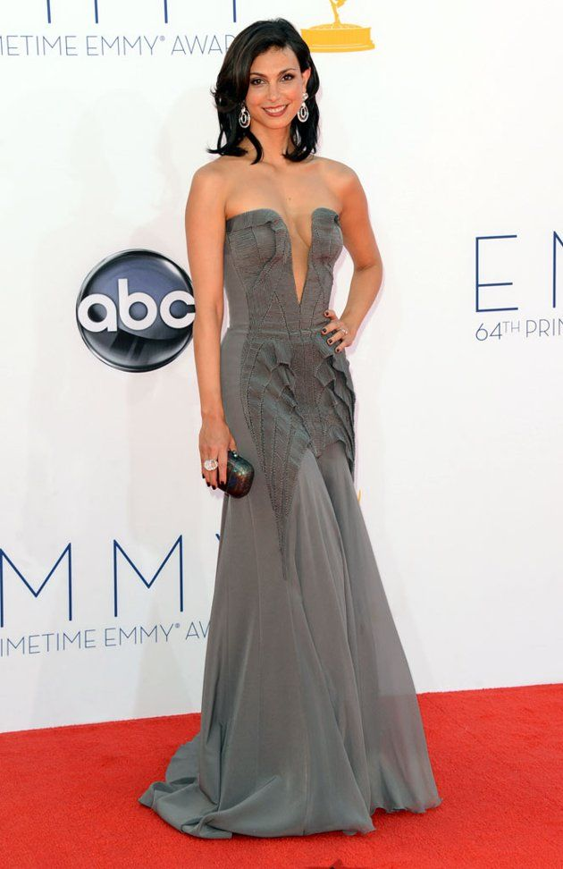 """""""Homeland"""" actress Morena Baccarin proved she's not afraid to take a risqué risk in a steel-gray dress by Basil Soda featuring a super-plunging neckline and chiffon skirt. A small clutch, big drop earrings by David Webb, and simple hair rounded out her look."""