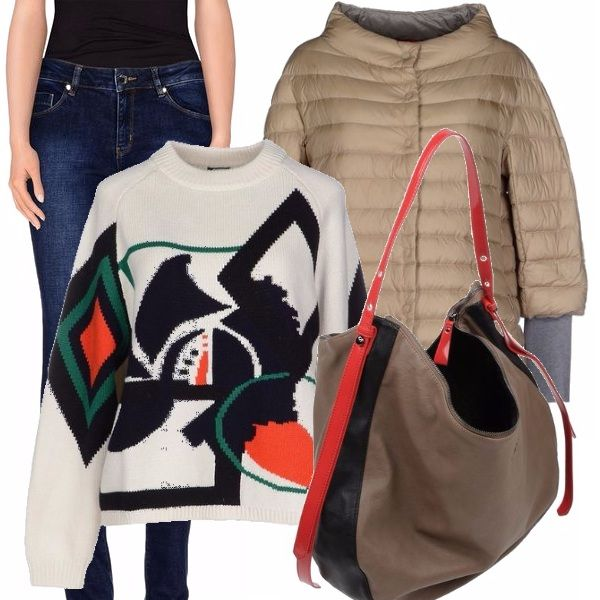 Ci piacciono tantissimo le geometrie del maglione, abbinato alla borsa ad un jeans skinny blu ed ad un piumino nei colori neutri. Borsa a spalla anch'essa particolare per creare un insieme decisamente insolito