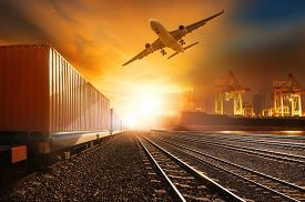 pic of railway tracks - industry container train running on railways track and commercial ship in port plane air cargo flying above use for land air and vessel transport industry and logistic business - JPG