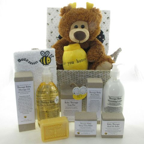 Buzzy Bear in a Basket baby hamper. filled with Aromatherapy Co's baby therapy range of products.