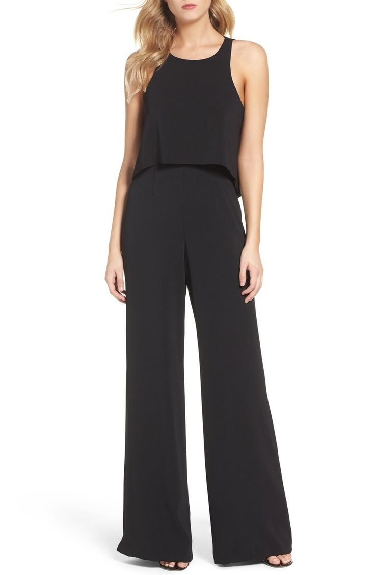 Angled shoulders and a cutout back create a contemporary silhouette in this sleek wide-leg jumpsuit.