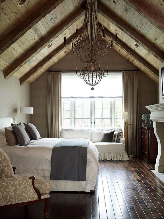 Traditional Guest Bedroom with Exposed beam, interior wallpaper, Hardwood floors, Cathedral ceiling, Chandelier