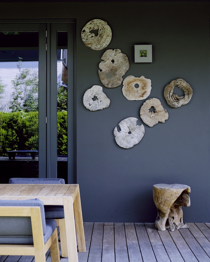 Wood slabs on wall as decoration or use with outside dining, placemats or hot plates. Smart!
