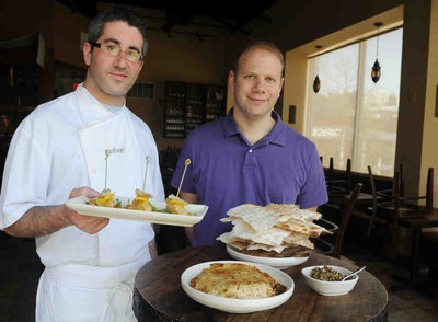 Michael Solomonov (left) and Steve Cook with Passover menu items at Zahav.