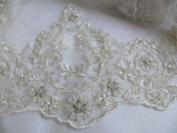 Beautiful beaded sequin lace trim. Ivory.