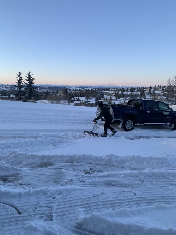 Professional snow removal company clearing a customers
