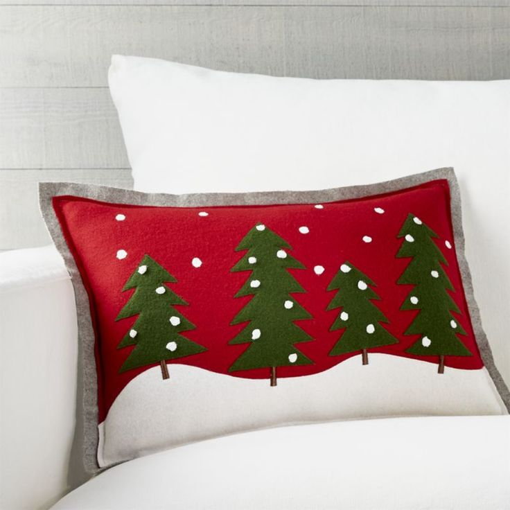 Shop Pine Tree Pillow.  Our cozy, folksy pillow, designed by Joan Anderson, creates a charming winter scene with appliqué and various embroidery techniques on felted wool.   A snowy grey flange surrounds.   Pillow reverses to grey felted wool.