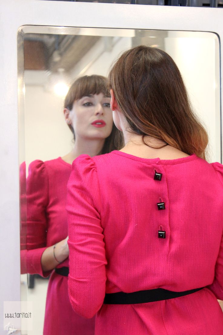 """Tarita FW13/14. Tarita """"Numero UNO"""" Collection. Fucsia cotton and viscose belted dress with long sleeves and black buttons on the back."""