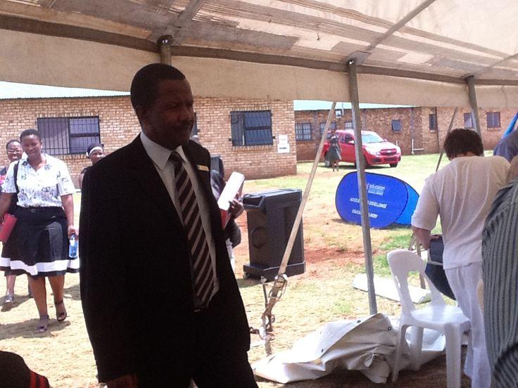 Mr. Joshua Mabogoane, Principal of the host school: Besilindile Primary School entering the tent.