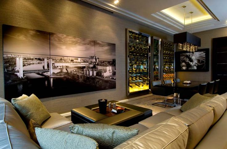Main living with hidden speaker panels and TV central unit. By thedesignpractice.com