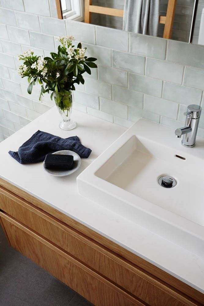arkee creative interior design. Caesarstone Frosty Carrina + powder blue subway tile