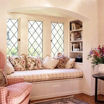 I think I'm a big fan of window seats! This one looks great with the windows and color scheme
