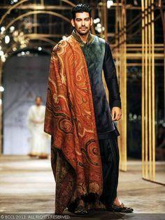 Sunil Singh walks the ramp for designer Tarun Tahiliani during India Bridal Fashion Week '13, held at Grand Hyatt, in Mumbai, on November 29, 2013.