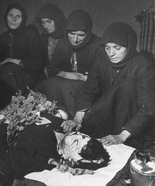 Civil War/Greece Greek women chanting a lament for the dead over the body of Apostolo Nasto who was killed by mortar fire.Location:Louzesti, Greece Date taken:1947 Photographer:John Phillips