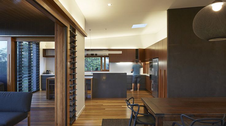 Kitchen area defined by being offset from other rooms in plan