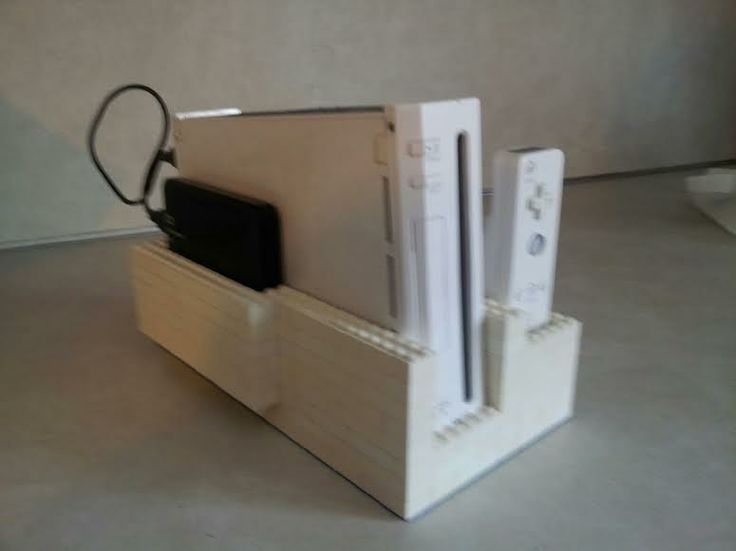 The used wii we ordered didn't have a stand, so we made our own out of legos - Imgur