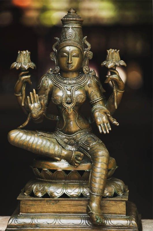 Sitting Lakshmi This 9 -inches bronze idol of Lakshmi featuring the goddess in sitting position is a unique piece of art. Visit our website- www.goodkarmastore.in- to check our range of artistic and religious idols.