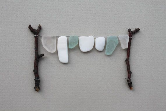 Sea glass and twigs....such a cute laundry room picture!
