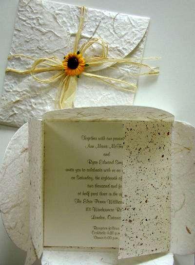 For invitations - liking the mini-sunflower and raffia.
