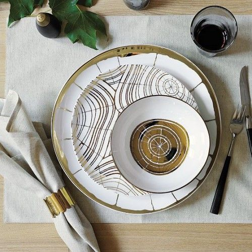 I cant find a designer but the Wood Slices Organic Dinnerware is one of my faves. found at http://makingitlovely.com/2010/10/22/wood-slices-organic-dinnerware/