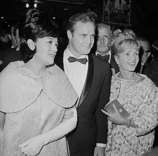 in 1960  Marlon Brando married for the 2nd time to actress Movita Castaneda - she was 6 years his senior and had appeared in the original Mutiny On The Bounty (1935) with Charles Laughton. They would have 2 children Miko and Rebecca and divorce in 1962 amid the scandal of Brando and his Mutiny on the Bounty (1962) co-star Tarita. Here is Brando with his 2nd wife and Debbie Reynolds at an awards ceremony.