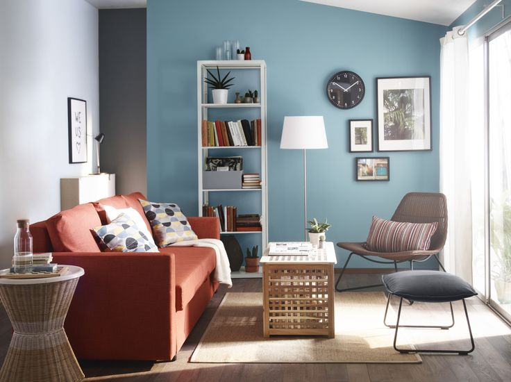A Light Living Room With An Orange Three Seat Sofa Bed Rattan Armchair Turquoise Footstool And Storage Table In Solid Acacia