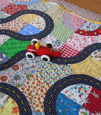 Racetrack Quilt. This is such a cute quilt for all those car loving toddlers.