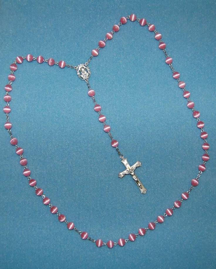 How to make a rosary This is the eye-pin and jump-ring method. easier than the wrapped wire method.