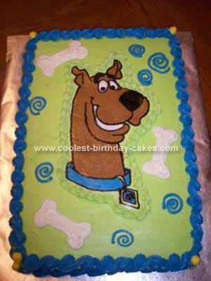 Homemade Scooby-Doo Cake: This Scooby-Doo Cake was done by using Frozen Butter Cream Transfer. I taped the picture to the back of a metal cookie sheet and then placed a piece of