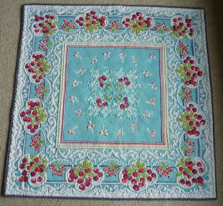 Aqua And Red Cherry Quilted Vintage Tablecloth. $1,500.00, Via Etsy.