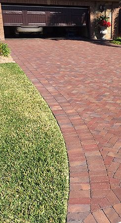 Rumbled Beale Street paver driveway. Pine Hall Brick.