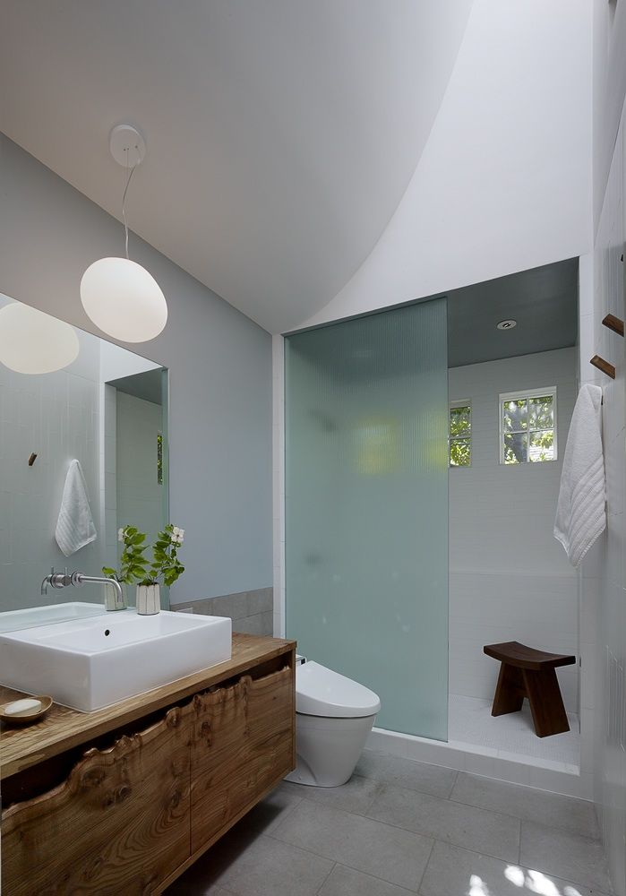 Be Here Now: A Zen Bath Remodel in Berkeley : Remodelista  Live edge cabinetry, plank floors, shower glass