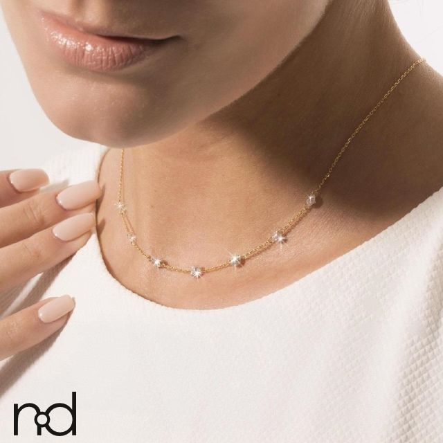 With Nude Diamond's Angel necklace, let the brightest stars shine down on you! With up to nine diamonds, the Angel necklace will give your neckline unmatched elegance and brilliance.     Diamond size: 7x0.20ct (3.8mm diameter)  Diamond quality:        - Color: H       - Clarity: SI1 / SI2  Gold color: 18K Rose    Handmade in Antwerp.  Shipped within 10 business days.  FREE FedEx delivery worldwide.  30-day money back guarantee. | Shop this product here: spree.to/a7tg | Shop all of our…
