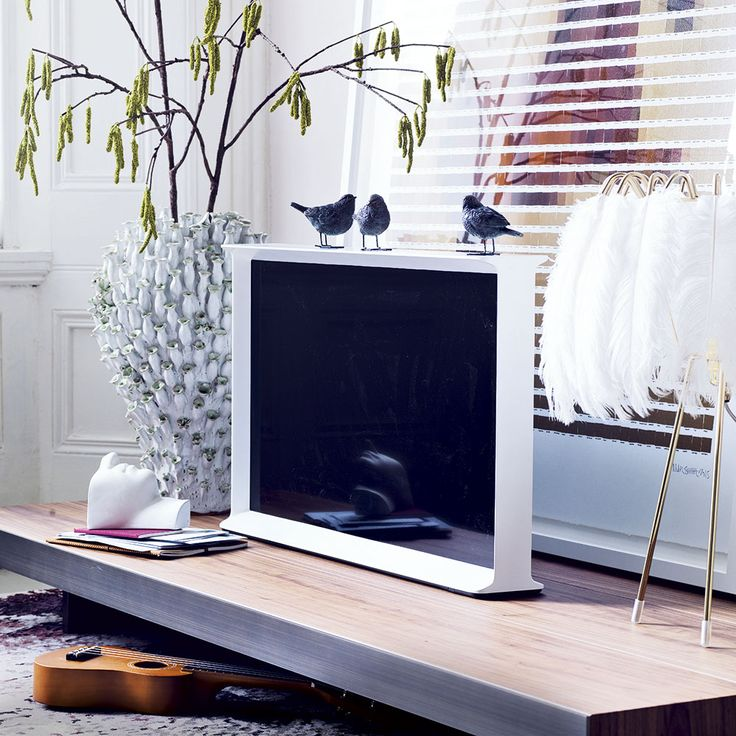 Living room TV display with statement vase and light