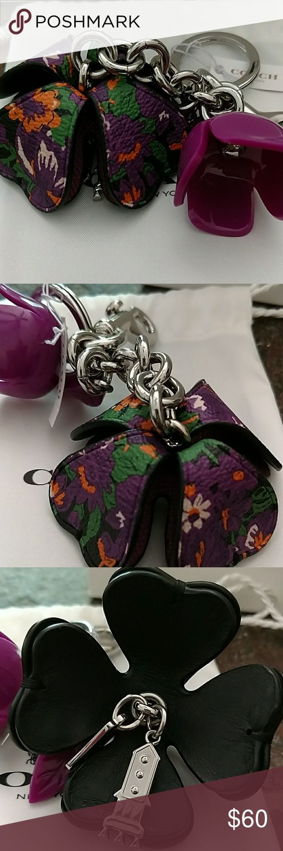 COACH TEAROSE KEYCHAIN COACH TEAROSE RESIN AND LEATHER KEYRING. PURPLE RESIN FLOWER AND LEAF. PURPLE FLOWERED LEATHER ROSE ATTACHMENT WITH  SILVER ATTACHMENT UNDERNEATH. SILVER KEYRING, CLIP AND CHAIN. NWT. COMES WITH EVERYTHING PICTURED. KEYCHAIN, COACH POUCH, COACH JEWELRY CARE MANUAL, COACH GIFT BOX. MADE PARTICULAR PIECE WAS MADE IN THAILAND. COACH Accessories Key & Card Holders