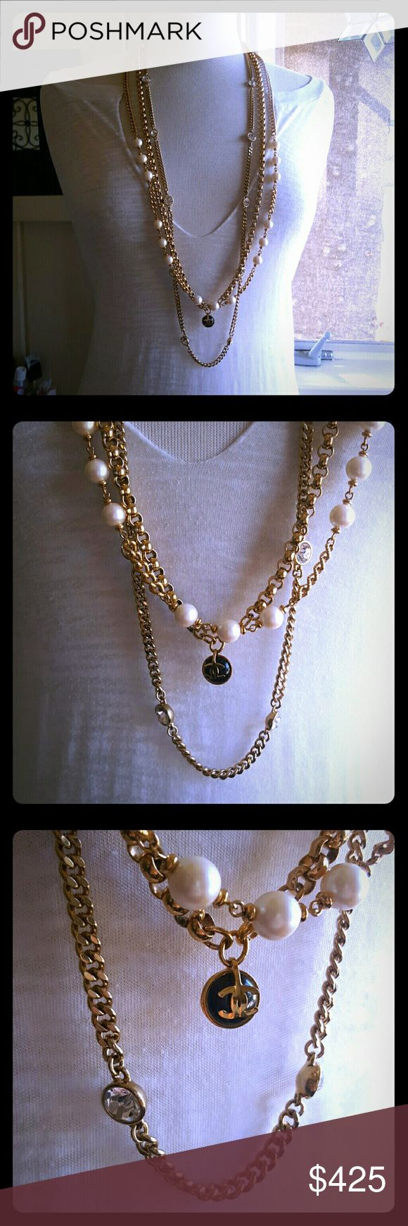 """CHANEL CC Pearl Necklace Authentic Chanel CC Pendant in high shine gold-tone and black onyx (dome cut onyx and design). Please note this Chanel pendant has been paired with three high end beautiful gold-tone necklace chains. The 40"""" Givenchy chain has large Swarovski clear crystals; 2nd chain is 36"""" vanilla faux pearls and gold plated links: 3rd 36"""" chain are interlocking circular links w a gold plated lobster clasp. These are all in like new condition, and quite extraordinary! Fast ship…"""