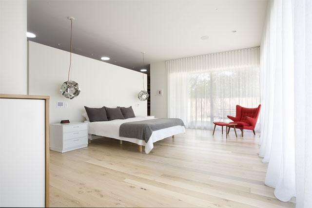 Very Minimalist Bedroom With White Oak Wood Floors