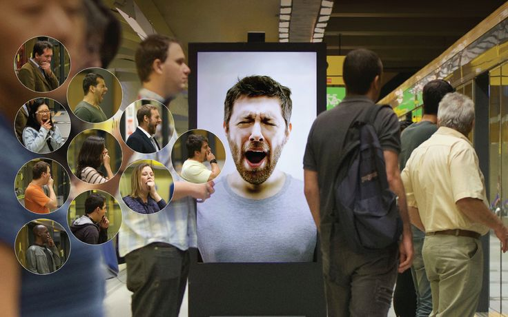Contagious Billboard makes you yawn, then gives you coffee - Apparently, 70% of people yawn when they see someone else is yawning. Using a hidden motion sensor, the billboard knows when and how many people pass in front of it. The man on the screen starts yawning when the time is right, triggering a series of yawns amongst the commuters. Café Pele representatives then appear with trays of coffee, handing the espresso shots out to those in need.