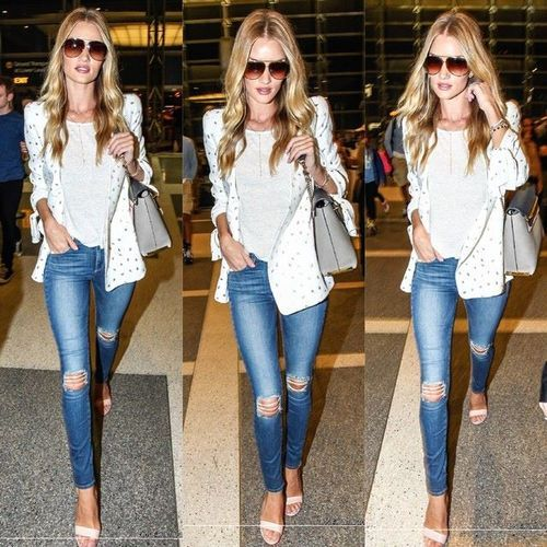 Rosie Huntington-Whiteley street style with blazer and skinny ripped jeans.