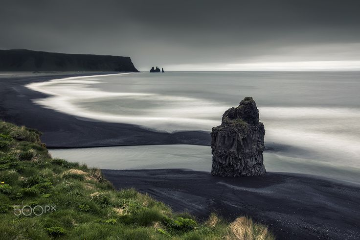 "Reynisfjara Beach and ""Eagle rock"" basalt column - Dyrhólaey, South Iceland Arnardrangur Reynisfjara Beach a typical rainy  day back in June .Please  <a href=""https://www.facebook.com/YiannisPavlis4"">Visit me on Facebook!</a>."