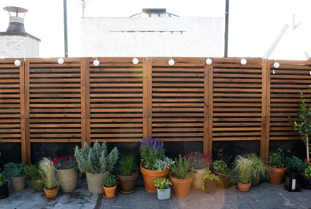 Ikea applaro wall panels as foundation cover on patio
