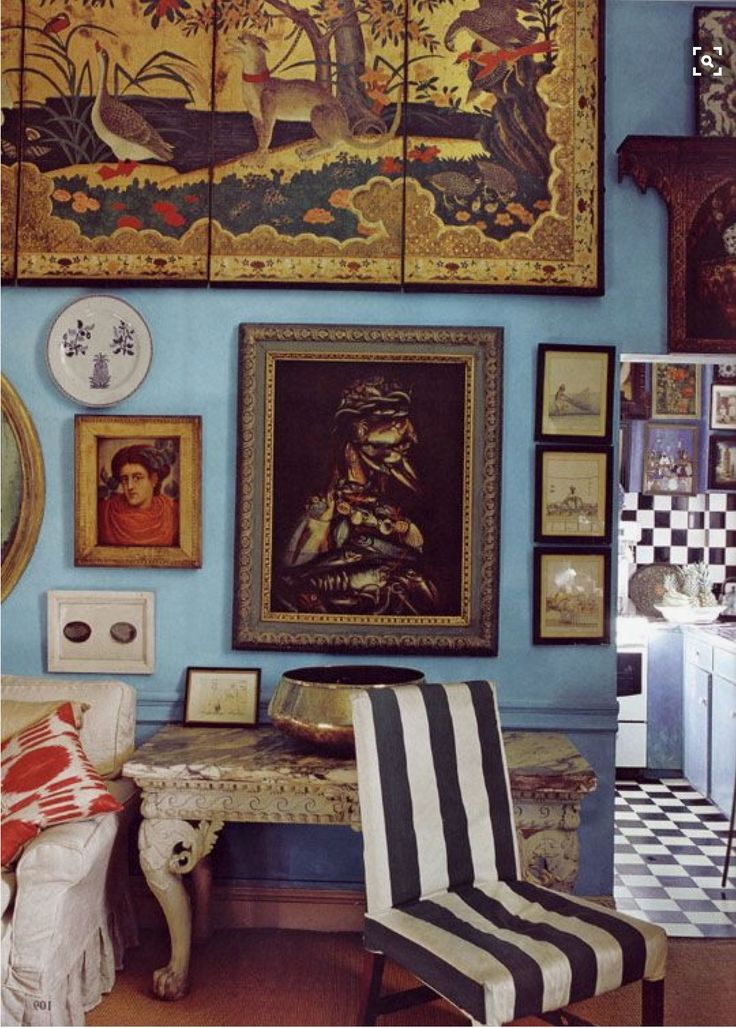 The gold of the paintings set against that perfect milk-washed blue wall is one of the most beautiful things I've ever seen.  A very inspiring room and home belonging to Peter Hinwood.