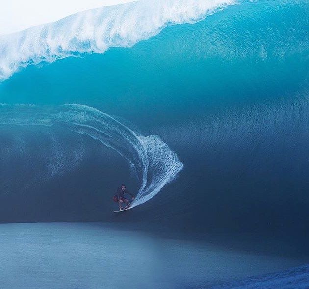 Keala Kennelly pulls into a crazy, heavy death defying Teahupoo wave. Photo Brent Bielmann