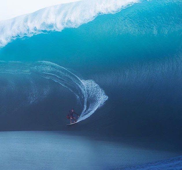 Keala Kennelly pulls into a crazy, heavy death defying Teahupoo wave. Photo Brent Bielmann