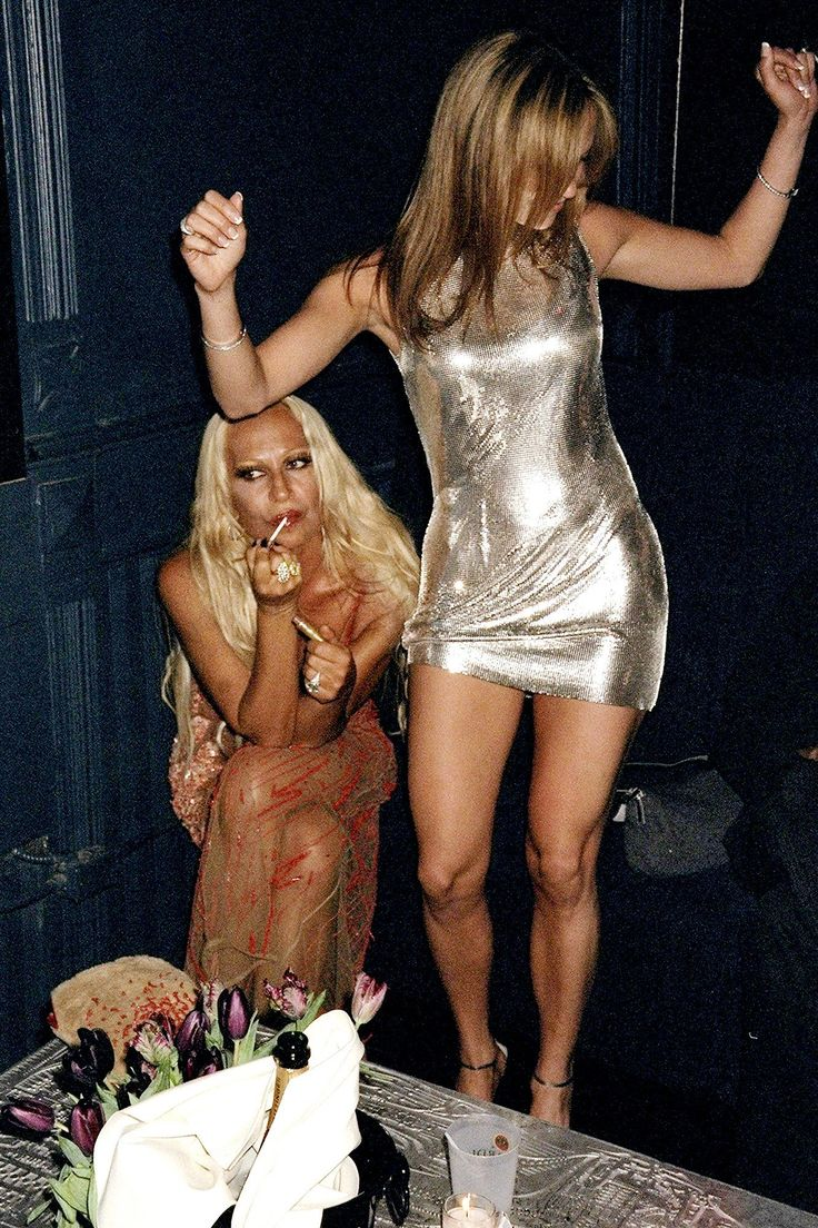 Donatella Versace knows the importance of reapplying lipgloss throughout the night. Even in the middle of a dance party with Jennifer Lopez.